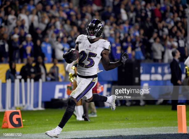 Tavon Young of the Baltimore Ravens scores a touchdown on a fumble recovery to give the Ravens a 2210 lead over the Los Angeles Chargers during a...