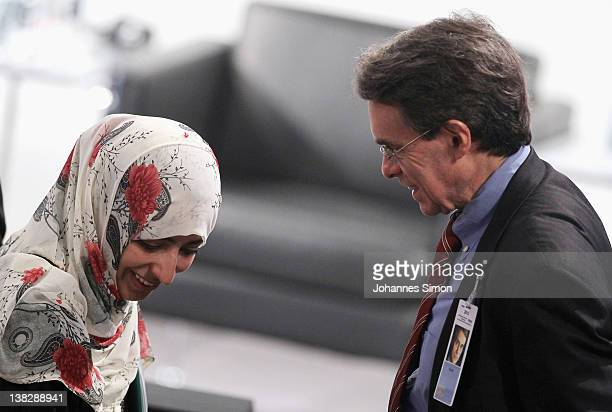 Tawakkul Karman Nobel peace laureate 2011 and Kenneth Roth executive director of Human Rights Watch chat together during day 3 of the 48th Munich...
