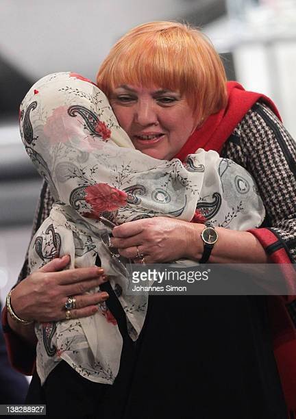 Tawakkul Karman Nobel peace laureate 2011 is hugged by Claudia Roth chairwoman of Alliance90/ The Greens during day 3 of the 48th Munich Security...