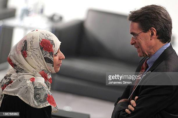 Tawakkul Karman Nobel peace laureate 2011 speaks to Kenneth Roth executive director of Human Rights Watch during day 3 of the 48th Munich Security...