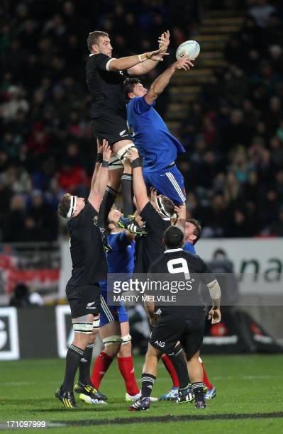 Tawera KerrBarlow of New Zealand jumps for the line out ball with Alexande Flanquart of France during the third rugby union match between the New...