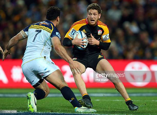 Tawera Kerr-Barlow of the Chiefs is tackled by George Smith of the Brumbies during a Super Rugby Final match between the Chiefs and the Brumbies at...
