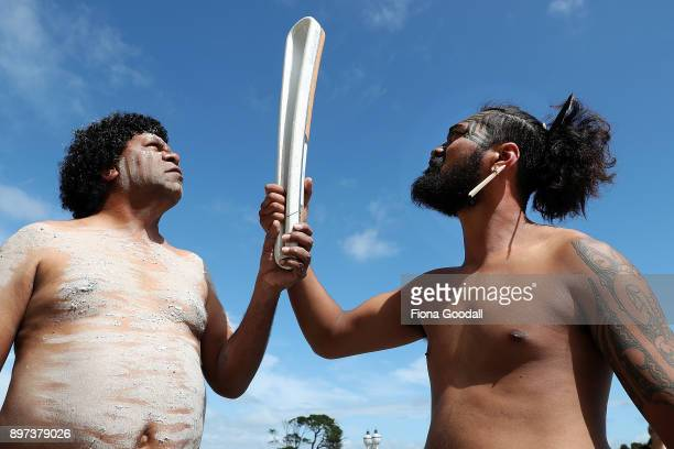 Tawera Wilson of Ngati Whatua and Jason Sandy of the Yugambeh clan hold the Queens Baton at Auckland War Memorial Museum during the Commonwealth...