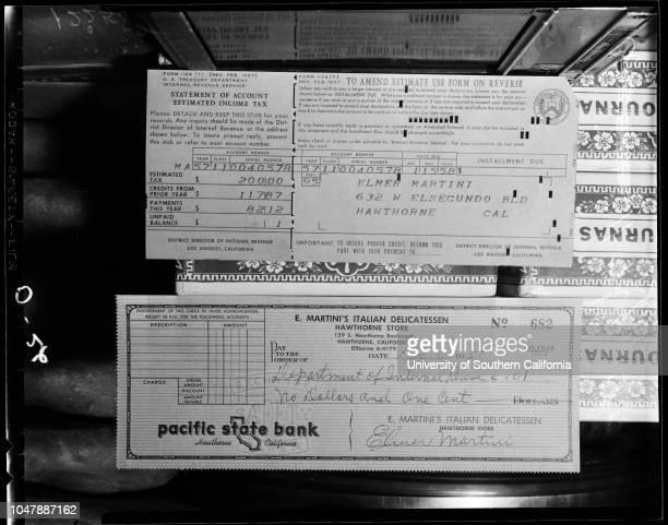 Tax bill for one cent sent by Internal Revenue 6 December 1957 Elmer Martini Caption slip reads 'Photographer Olmo Date Reporter Ostler Assignment...