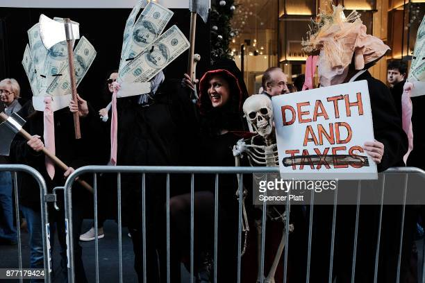 Tax cut protesters watch as New York City Mayor Bill de Blasio joins other Democratic officials labor members and activists in front of Trump Tower...
