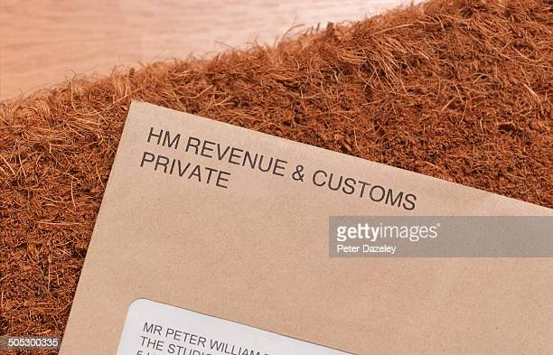 tax demand on doormat - monogram stock pictures, royalty-free photos & images