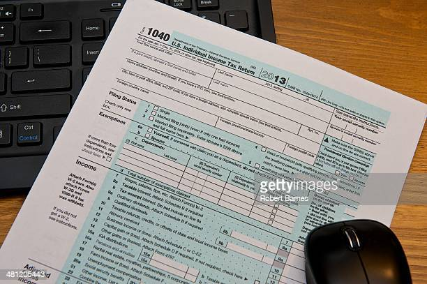 Tax Filing Electronically with an IRS 1040 Tax Form on top of a computer keyboard and mouse
