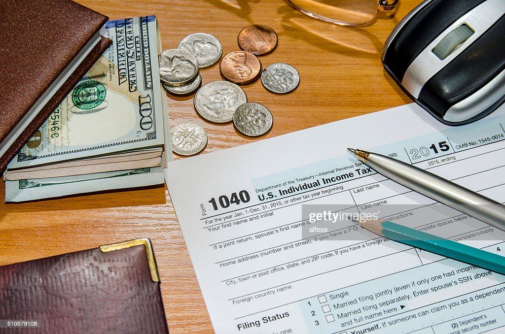 Tax Form 1040 For 2016 With Pen Money Notepad Calculator
