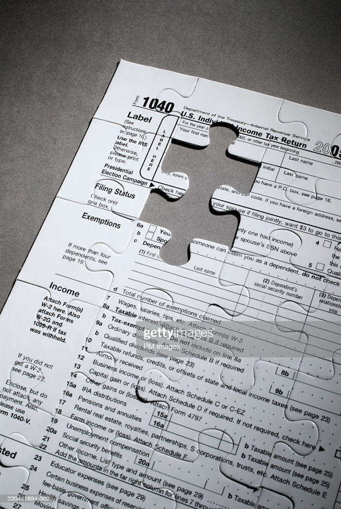 Us Tax Form 1040 With Jigsaw Puzzle Piece Cut Out Stock Photo
