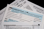 2019 US/IRS tax forms lay on a desktop
