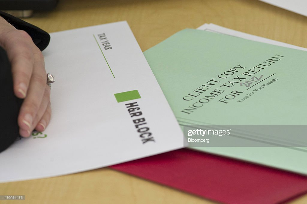 Tax forms sit on a desk at an H&R Block, Inc. office in San Francisco, California, U.S., on Friday, March 14, 2014. The deadline for filing 2013 U.S. taxes is April 15. Photographer: David Paul Morris/Bloomberg via Getty Images