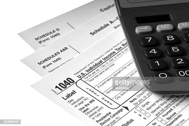 tax forms with calculator - 1040 tax form stock photos and pictures