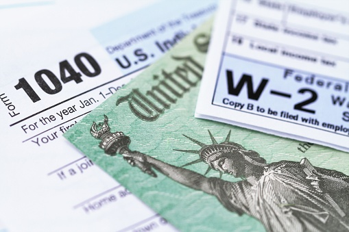 IRS tax forms with tax refund check 1126336374