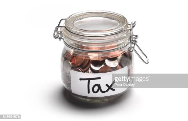 Tax jar of money coins