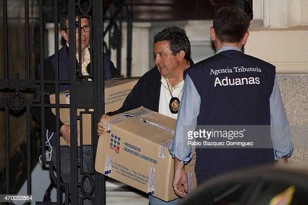 Tax office agents carry boxes during a raid at former IMF chief Rodrigo Rato's private office in fraud probe as police secures the area on April 16...