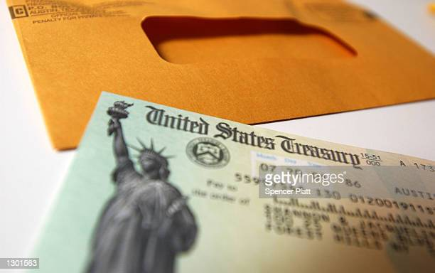 A tax payer rebate check sits on a table July 25 2001 in New York City The US government is sending out 92 million tax rebate checks over 10 weeks as...
