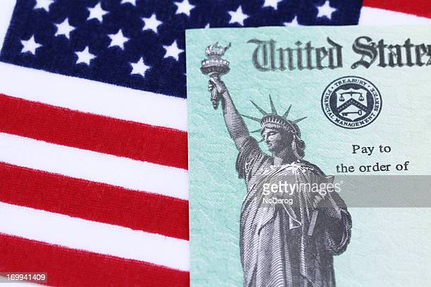 IRS tax refund check on American flag
