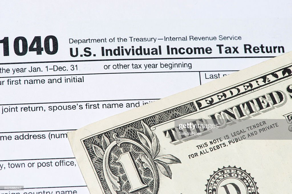 Irs Tax Return Form 1040 And Dollar Bill Stock Photo - Getty Images