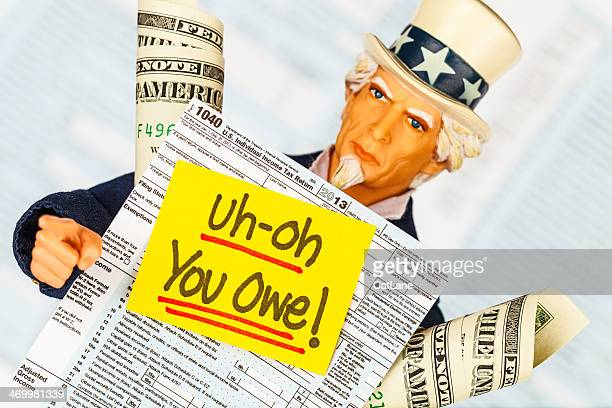 tax season: uncle sam with warning that you owe taxes! - irs stock photos and pictures