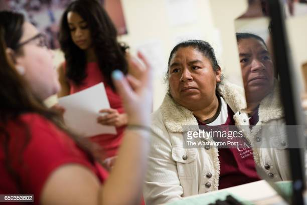 Tax site coordinator Andrea Padilla left explains taxes to Eladia of Bladensburg Eladia is from Guatemala and has been living undocumented in the...