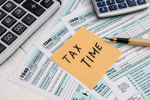 'Tax time' memo on 1040 individual tax form 1178314435