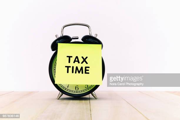 Tax Time Text on Adhesive Note on Alarm Clock