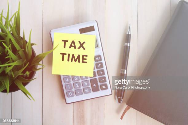 Tax Time text on adhesive note