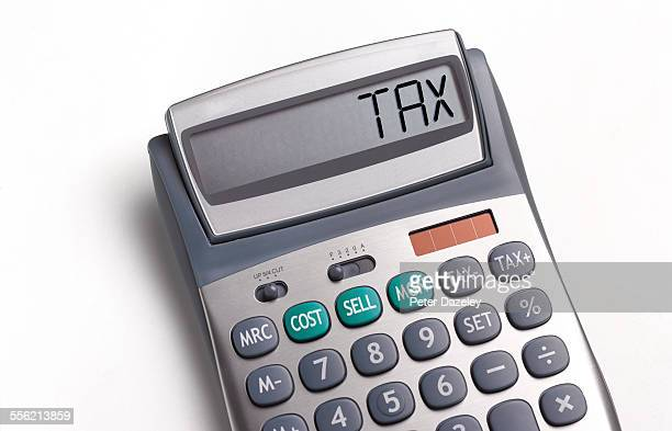 tax written on a calculator - tax stock pictures, royalty-free photos & images