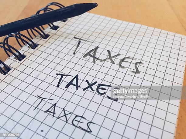 Taxes Written On Diary