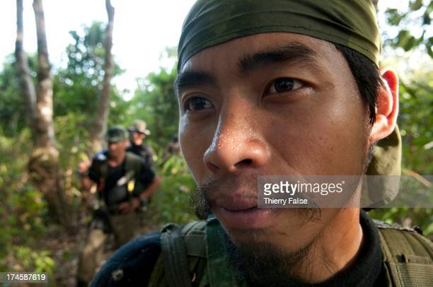 Taxi a security member of the relief group Free Burma Rangers walks through a forest on his way to a displaced people community in Northern Karen...