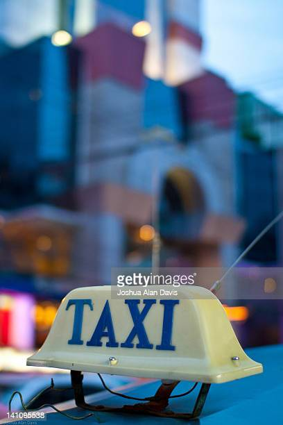 taxi and neon lights at night - joshua alan davis stock pictures, royalty-free photos & images
