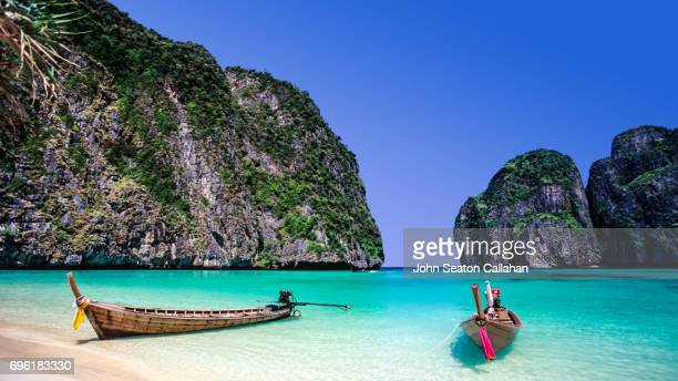 taxi boats at maya bay - phi phi islands stock-fotos und bilder