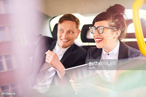 taxi business couple - car pooling stock photos and pictures