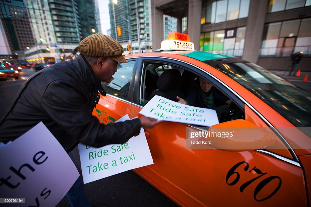Taxi cab driver Dereje Alemu hands out protest signs in
