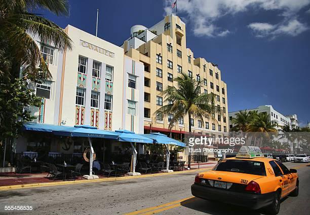 A taxi cab driving along Ocean Drive, Miami Beach