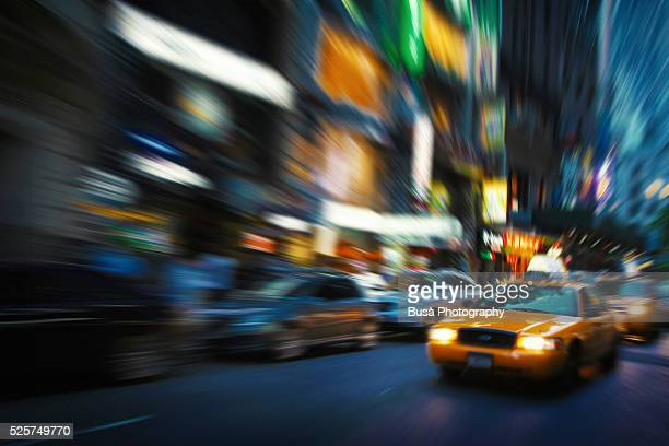 Taxi cab driving in the streets of Manhattan at twilight