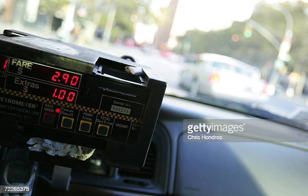 A taxi cab meter reads $ 390 in midtown Manhattan October 25 2006 in New York New York's taxi commision voted to raise taxi rates in the city...