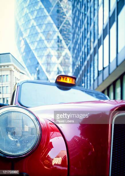 Taxi Cab Parked at the front of Swiss Re Tower, City of London, London, UK