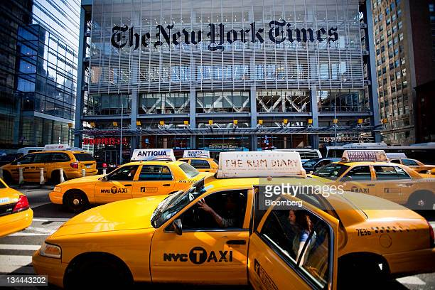 Taxi cabs drive past The New York Times Co headquarters in New York US on Tuesday Oct18 2011 The New York Times Co is scheduled to release quarterly...