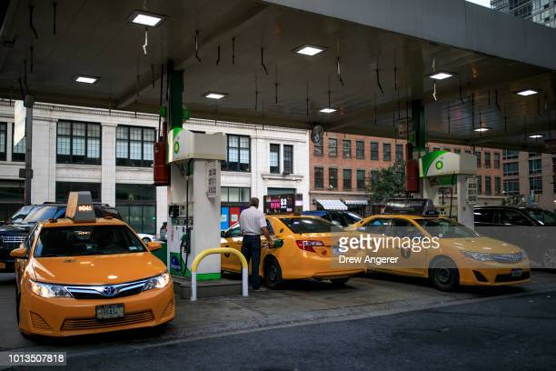 Taxi cabs fill up at a BP Gas station on the West Side of Manhattan August 8 2018 in New York City On Wednesday New York City became the first...