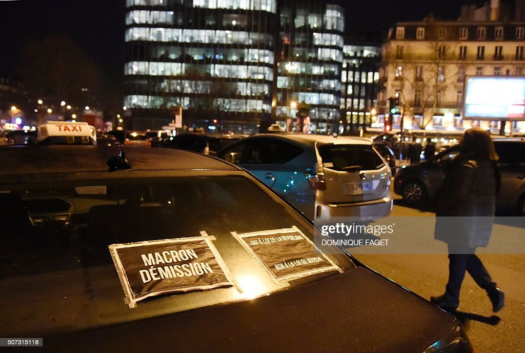 Taxi cabs line-up during a protest at Porte Maillot in Paris against ...