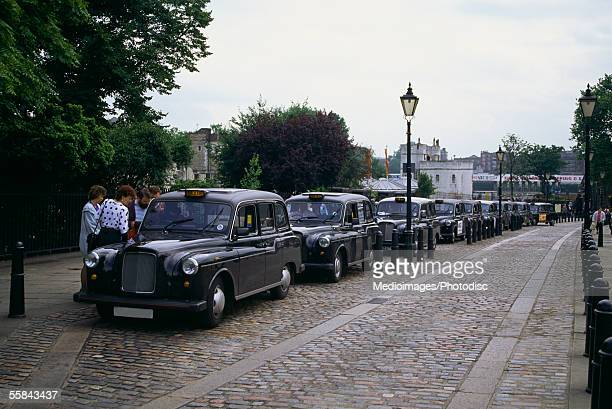Taxi cabs parked in a row, London, England