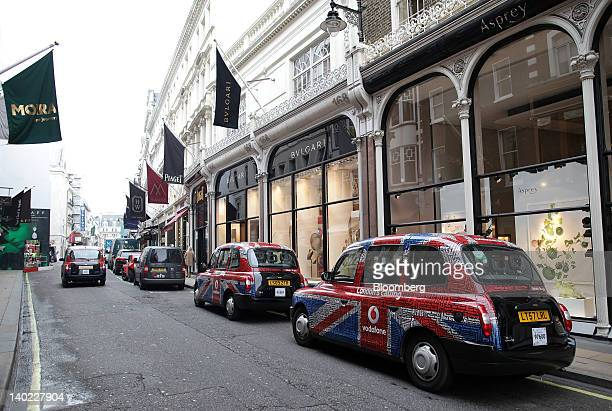 Taxi cabs sit outside the Asprey and Bulgari SpA stores on New Bond Street in London UK on Wednesday Feb 29 2012 Bank of England Deputy Governor...