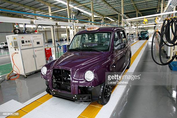 Taxi cabs stand in the assembly line in SMA factory plant on October 24 2008 in Fengjing outside Shanghai China London Taxi International the...