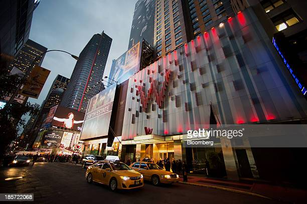 Taxi cabs stop in front of the W Hotel New York Times Square a Starwood Hotels Resorts Worldwide Inc property in New York US on Wednesday Oct 23 2013...