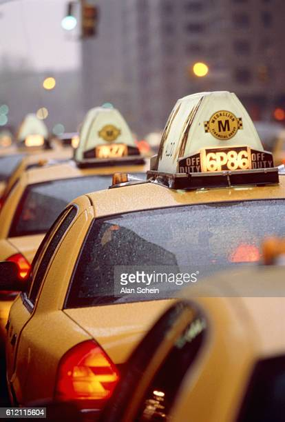 Taxi cabs waiting in row, New York City