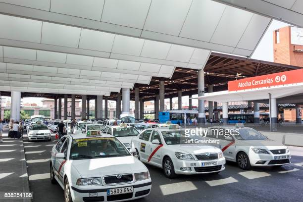 Taxi cabs waiting outside Madrid Puerta de Atocha railway train station