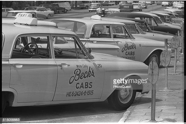 Taxi cabs with sign 'White Only Beck's Cabs' on side Albany Georgia August 18 1962
