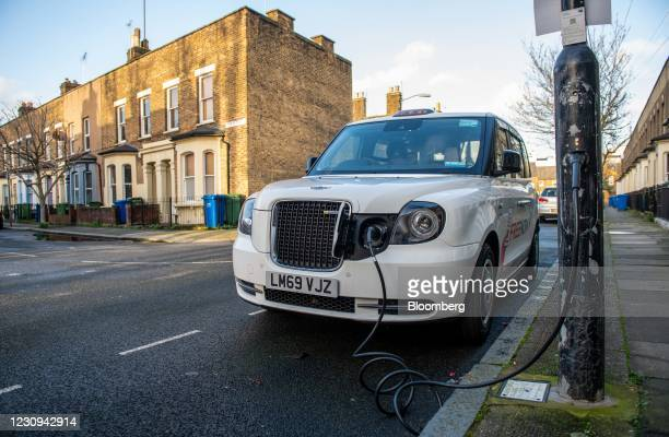 Taxi charges at an Ubitricity plug-in electric vehicle charging station on a residential street in London, U.K., on Tuesday, Feb. 2, 2021. Royal...