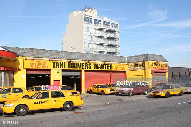 A taxi depot foreground lies adjacent to Hotel Le Bleu in the Brooklyn borough of New York US on Wednesday Oct 31 2007 Visitors at Hotel Le Bleu New...